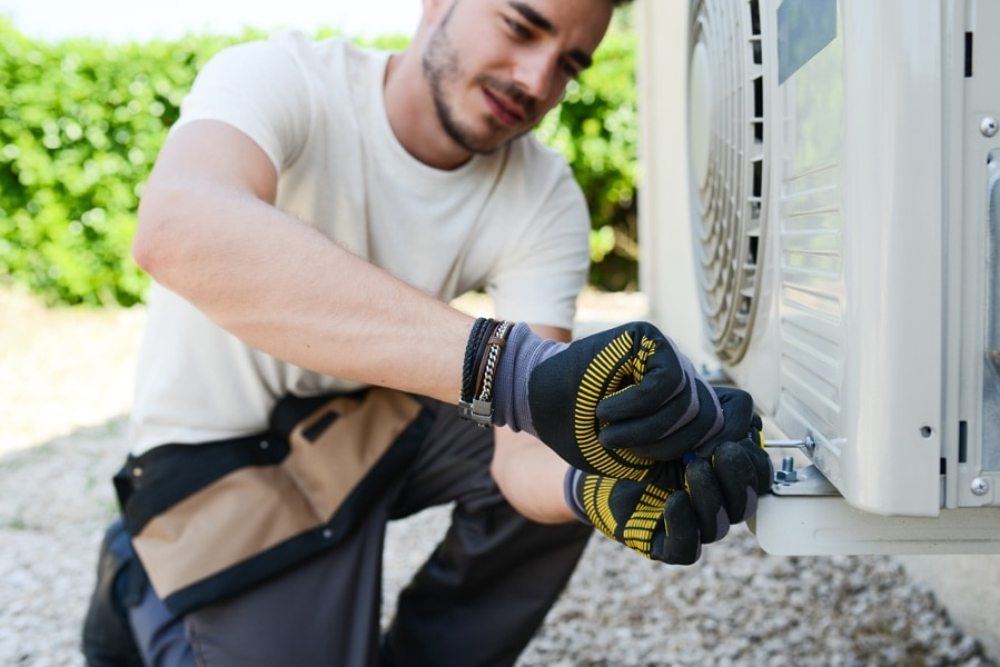 HVAC-repairman-fixing-AC-copy