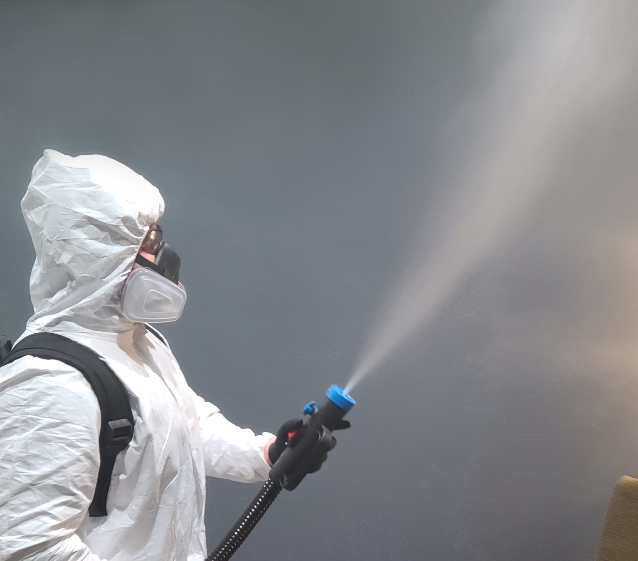 Sanitization tech cleaning a room.
